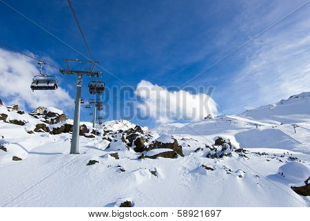 Chairlift Above Rocks