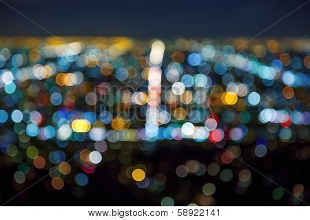 Los Angeles cityscape at night with lights blurred into abstract bokeh circles background.