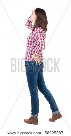 Back view of shocked woman in checkered shirt. girl hid his eyes behind his hands.  Rear view people collection.  backside view of person.  Isolated over white background.