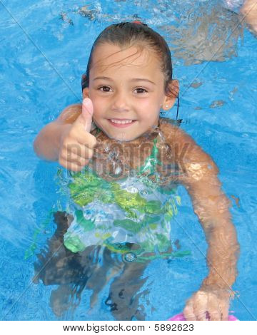"""Little Girl giving the """"Thumbs Up"""" sign in the Swimming Pool"""