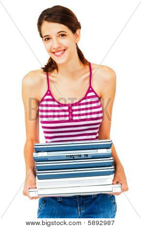 Smiling Woman Holding Stack Of Laptops