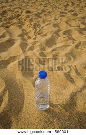 Empty Bottle In Sand