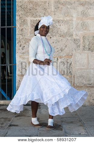 HAVANA,CUBA - JANUARY 20, 2014:Afro woman dressed with typical clothes.Characters like this are common in the streets of Old Havana and a photo opportunity for the growing number of foreign tourists