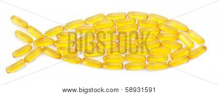 Fish oil pills arranged as a fish on white background