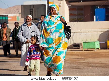 WADI HALFA,SUDAN - JANUARY 07,2010: Sudanese people meet a ferry from Egypt  in border town Wadi Halfa.