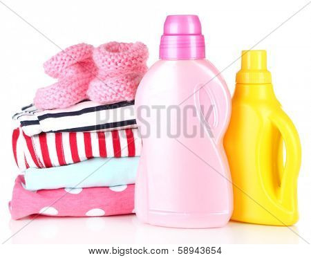 Softener dryers and children clothes isolated on white