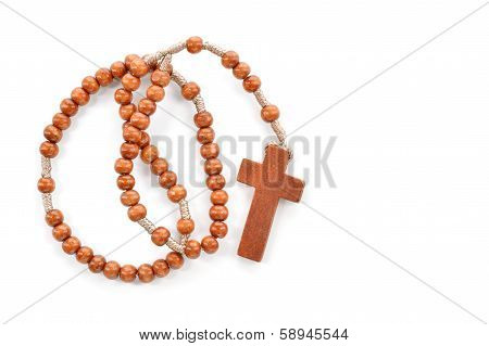 Wooden Plain Rosary On White Background.