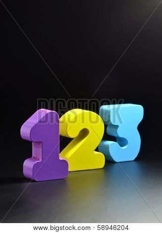 Color wooden blocks in a shape of numbers. Focus on first 1 number.