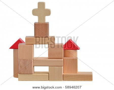 Small church build with wooden blocks toy. Isolated on white background with path.