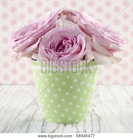 Pink Flowers In A Green Polkadot Vase