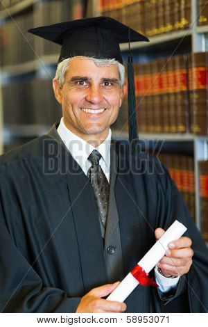 cheerful mid age male law school graduate holding diploma