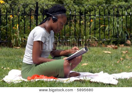 Reading And Listening To Music In The Park