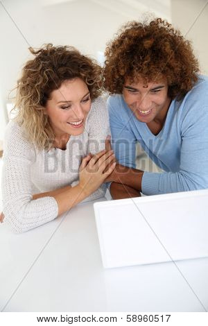 Couple websurfing on laptop computer