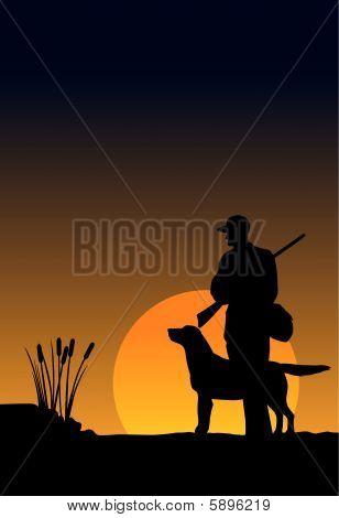 Hunter und Hund bei Sonnenaufgang