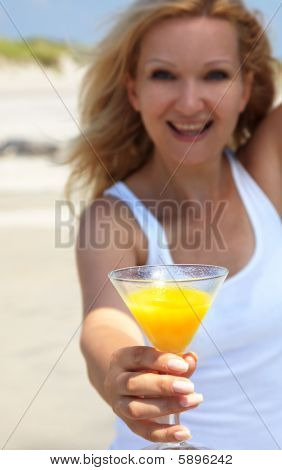 Happy Young Blond Woman With Glass Of Oranje Juice