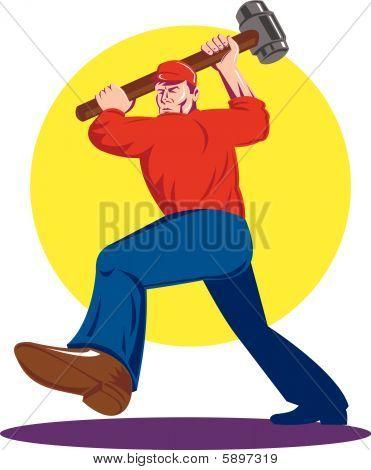 Masculino trabalhador impressionante com uma marreta