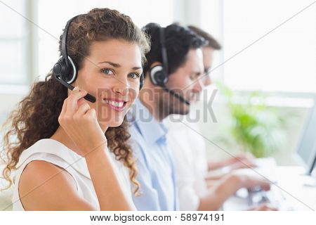 Portrait of confident female call center agent working in office