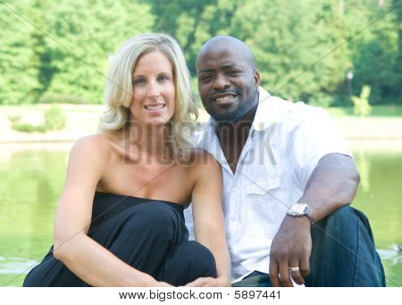 A Beautiful Mixed Race Couple Enjoying The Park