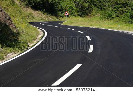 winding road black asphalt