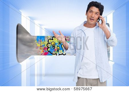 Clueless male on his cellphone against bright blue room with windows