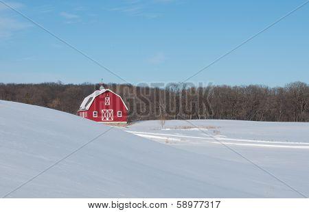 Red barn in winter landscape