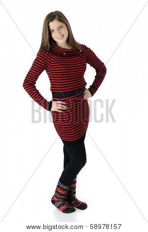 Full length image of a beautiful young teen in her knit red and black striped dress, black tights and crazy socks.  On a white background.