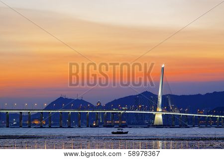 long Bridge over sunrise in hongkong shenzhen bay