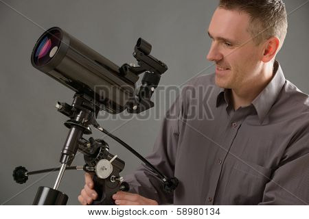 Man with astronomical telescope