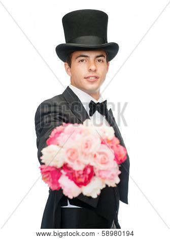 magic, performance, circus, show concept - magician with flower bouquet
