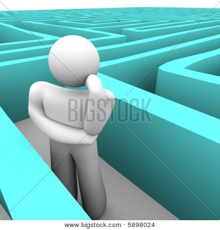 Person In Blue Labyrinth Thinking Of Way Out