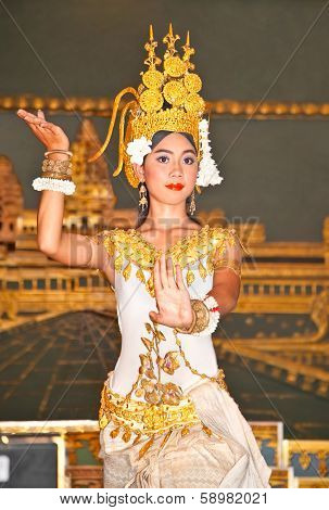 SIEM REAP, CAMBODIA - NOV 21. 2013: Khmer classical dancers performing in traditional costume on Nov 21, 2013 in Siem Reap, Cambodia. Apsara Dance is the ancient classical dance form of Cambodia.