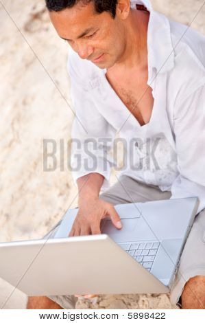 Man At The Beach With Laptop