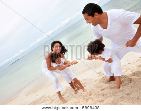 Family Pulling A Rope