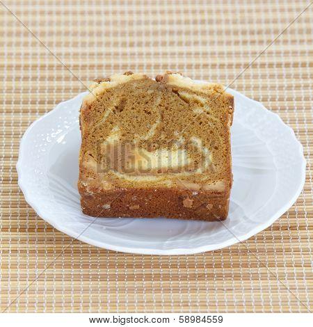 Sponge cake mocca on bamboo plate background