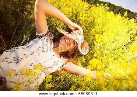 Happy Woman Lying Among Yellow Wildflowers
