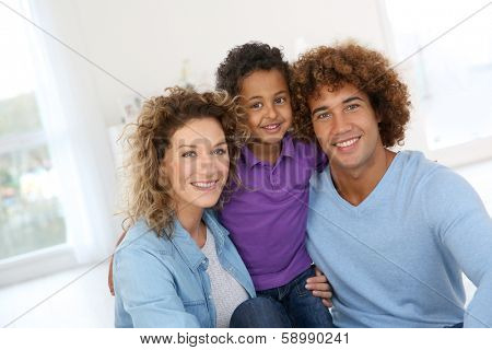 Happy family laying down the floor at home