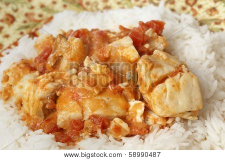 Basic fish curry, in a spicy tomato and coconut milk sauce, served on a bed of basmati rice.