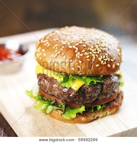 burger with sesame bun and melted cheese close up