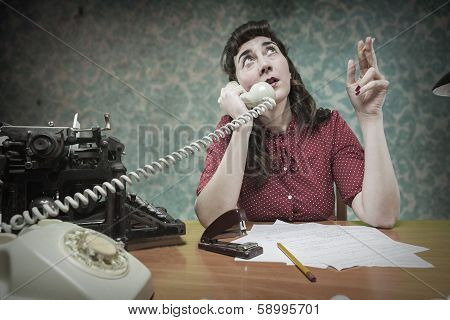 Young Secretary Smoking A Cigarette While Talking On The Phone, 1960's Scene