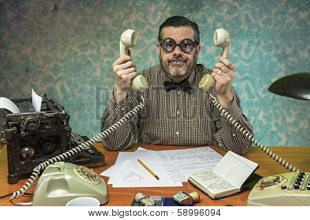 Employee with glasses talking on the phone in the office in the 1960s