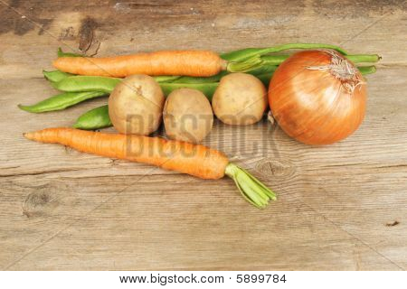 Selection Of Vegetables On Rustic Wood