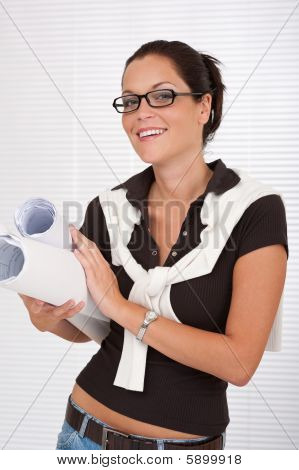 Smiling Female Architect Holding Plans
