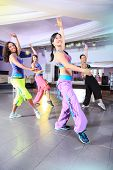 foto of zumba  - young women in sport dress at an aerobic and zumba exercise - JPG