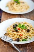 pic of italian parsley  - Italian pasta and mushroom sauce over rustic old wood - JPG