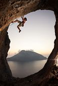 pic of cave woman  - Female rock climber at sunset - JPG