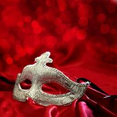 stock photo of venetian carnival  - Vintage venetian carnival mask on red background - JPG