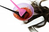 foto of hair dye  - Bowl with hair dye and brush for hair coloring - JPG