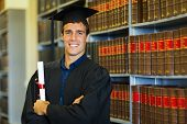 picture of laws-of-attraction  - handsome university law school graduate in library - JPG