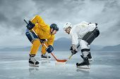 foto of frozen  - Ice hockey players on the ice - JPG
