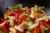 stock photo of green bean  - Chicken stir fry with red peppers onion and green beans - JPG